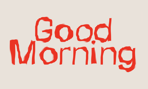The words 'Good Morning' written in large red typography that has jagged edges, set on a pale dusty pink background.